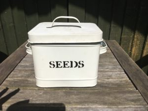 Tin containing packets of seeds